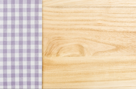 menue: Purple checkered table cloth on a wooden background