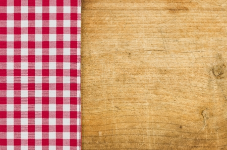 Rustic wooden background with a red checkered tablecloth photo