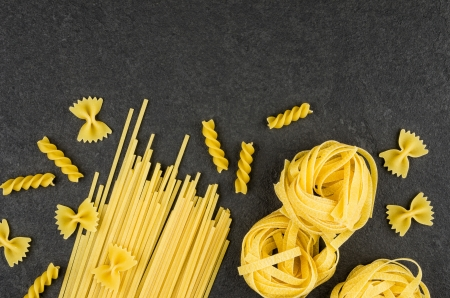 semolina pasta: Different types of pasta on a slate background Stock Photo