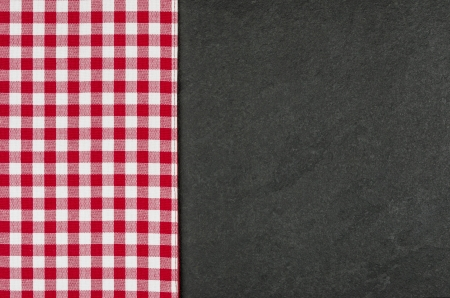 Slate plate with a red checkered tablecloth photo