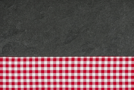 Slate plate with a red checkered tablecloth Stock Photo - 21217787