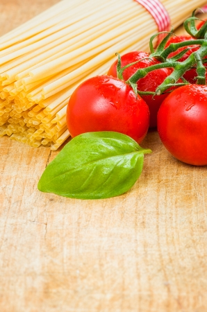 Spaghetti with tomatoes and basil photo