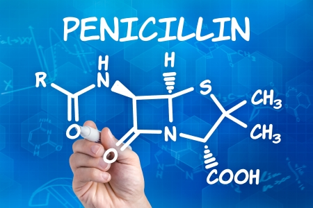 hand with pen drawing the chemical formula of Penecillin photo
