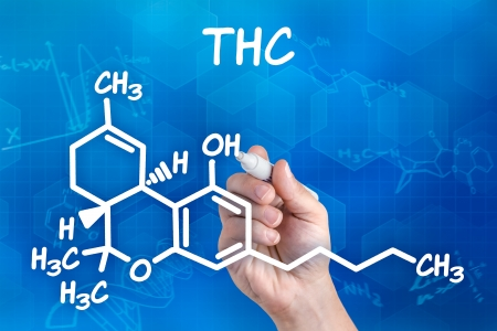 formulas: hand with pen drawing the chemical formula of thc Stock Photo