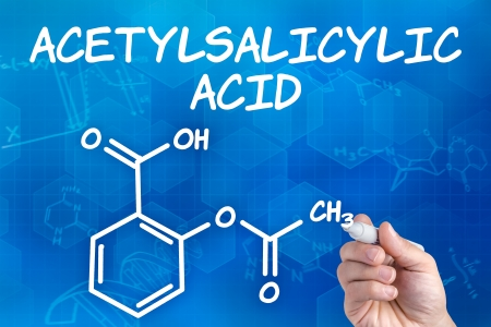 hand with pen drawing the chemical formula of acetylsalicylic acid photo