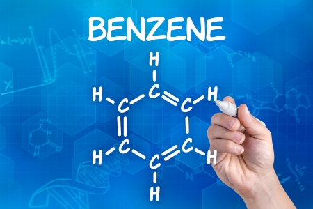 benzene: hand with pen drawing the chemical formula of benzene Stock Photo