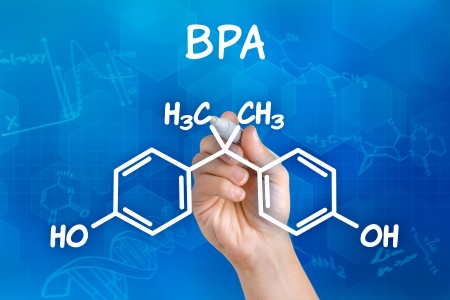 bpa: Hand with pen drawing the chemical formula of BPA