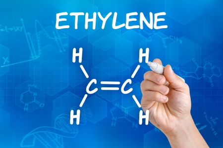 Hand with pen drawing the chemical formula of ethylene photo