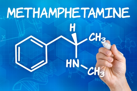 junkie: Hand with pen drawing the chemical formula of methamphetamine Stock Photo