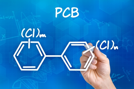 Hand with pen drawing the chemical formula of PCB photo