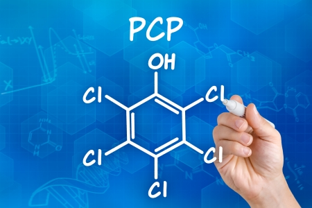 Hand with pen drawing the chemical formula of PCP photo