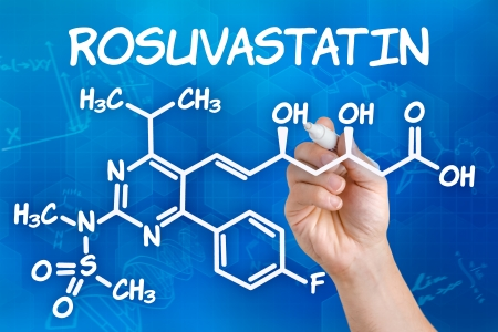 Hand with pen drawing the chemical formula of rosuvastatin photo