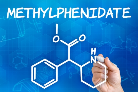 hyperactivity: Hand with pen drawing the chemical formula of methylphenidate