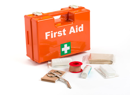 first aid sign: First Aid Kit with dressing material Stock Photo