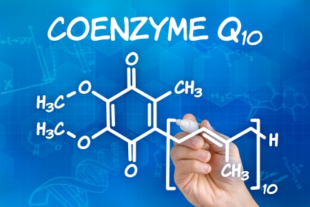 Hand with pen drawing the chemical formula of coenzyme Q10 Stock Photo - 24157221