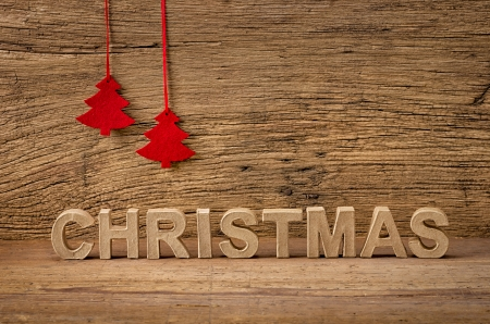 The word christmas in front of a rustic background photo