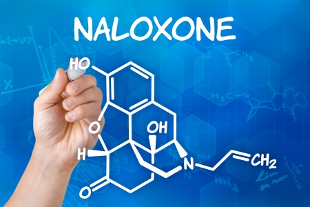 pen and marker: Hand with pen drawing the chemical formula of naloxone Stock Photo