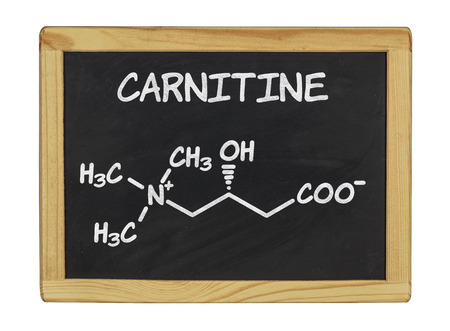 supplements: chemical formula of carnitine on a blackboard