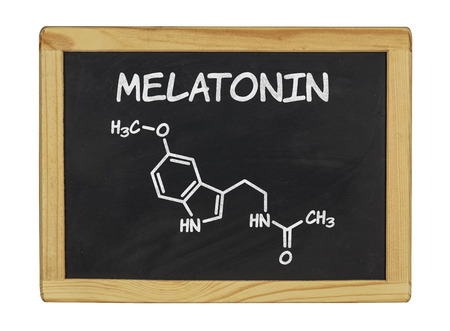 chemical formula of melatonin on a blackboard Stock Photo