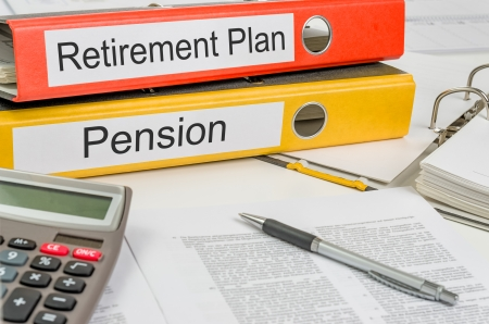 business savings: Folders with the label Retirement Plan and Pension Stock Photo