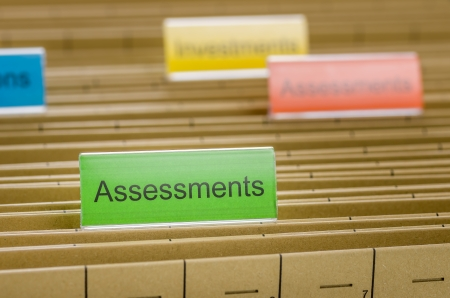 assessments: Hanging file folder labeled with Assessments Stock Photo