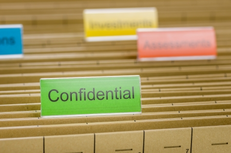 Hanging file folder labeled with Confidential photo
