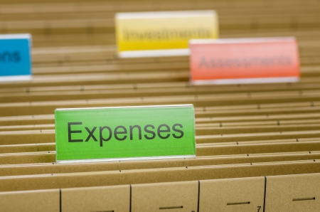 expenses: Hanging file folder labeled with Expenses