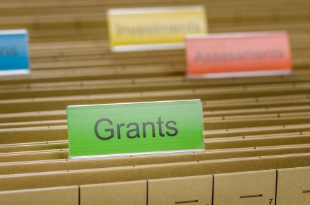Hanging file folder labeled with Grants photo