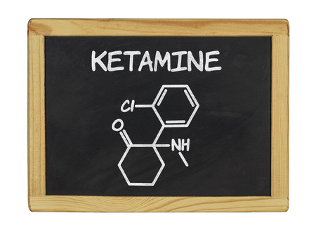 intoxication: chemical formula of ketamine on a blackboard Stock Photo