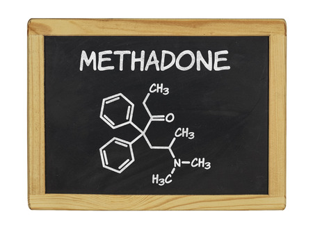 junkie: chemical formula of methadone on a blackboard Stock Photo