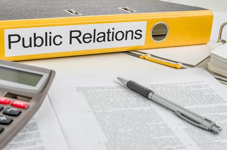relations publiques: Dossier avec l'�tiquette de relations publiques Banque d'images