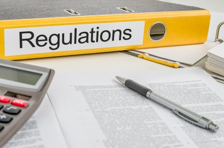 Folder with the label Regulations Stock Photo - 25571589