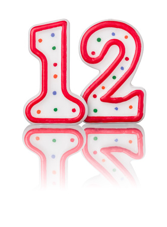 number candles: Red number 12 with reflection Stock Photo