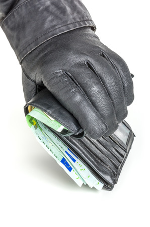 leather glove: Thief with leather glove is reaching for a wallet Stock Photo