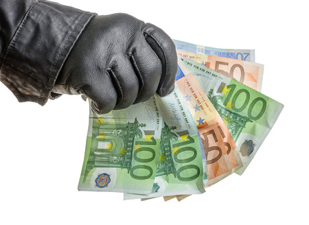 leather glove: Thief with leather glove is grabbing some bills