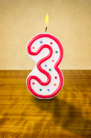 3 month: Burning birthday candle number 3