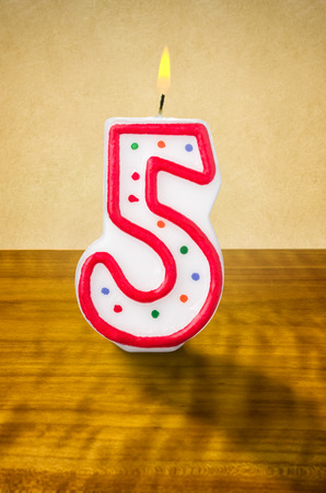 5th: Burning birthday candle number 5