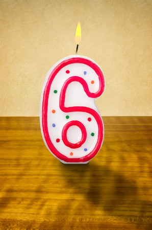 6th: Burning birthday candle number 6 Stock Photo