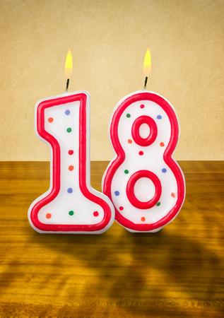 Burning birthday candles number 18 photo