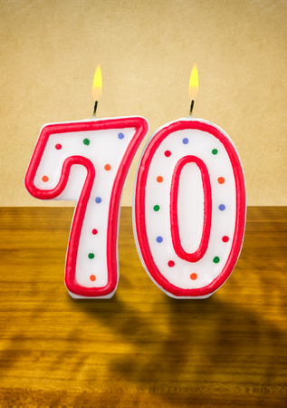 seventieth: Burning birthday candles number 70