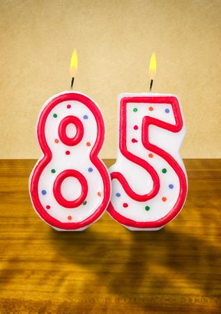 Burning birthday candles number 85 photo