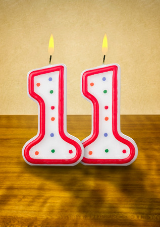 Burning birthday candles number 11 photo