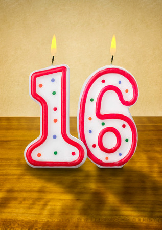 numerical: Burning birthday candles number 16 Stock Photo