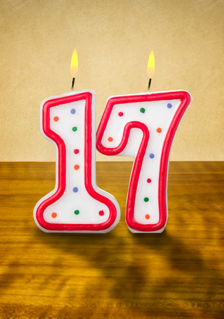 seventeenth: Burning birthday candles number 17 Stock Photo