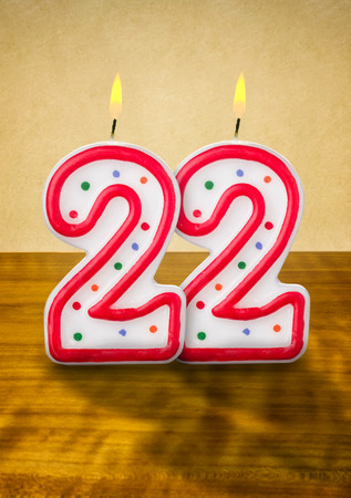 number candles: Burning birthday candles number 22 Stock Photo