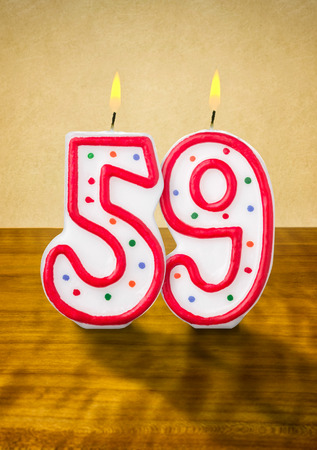 fifty: Burning birthday candles number 59