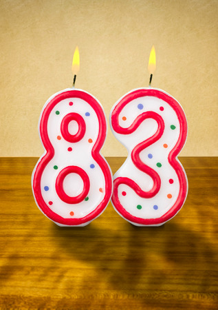 83rd: Burning birthday candles number 83 Stock Photo