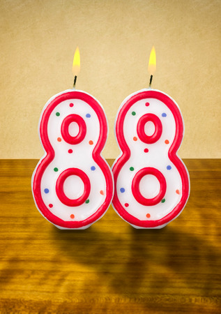 eighty: Burning birthday candles number 88 Stock Photo