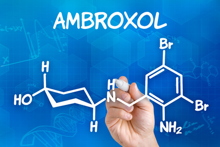 cough syrup: Hand with pen drawing the chemical formula of ambroxol