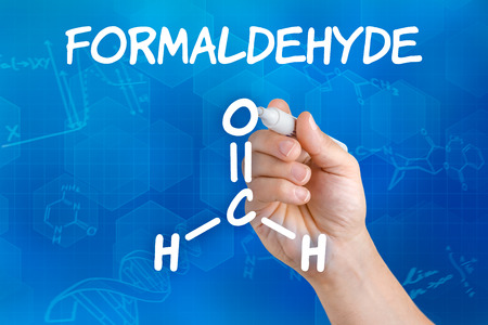 Hand with pen drawing the chemical formula of formaldehyde Stock Photo